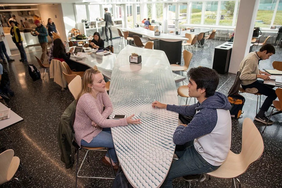 Maria McLaughlin '18 and Mauricio Ruiz '19 engage in conversation. Kris Snibbe/Harvard Staff Photographer