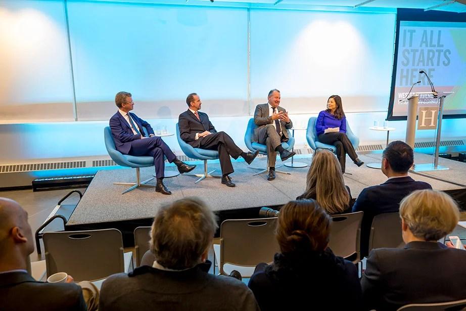 Panelists seated, from left, Shaun Donovan, Dean Frank Doyle, Stefan Behnisch, and Tracy Palandjian.