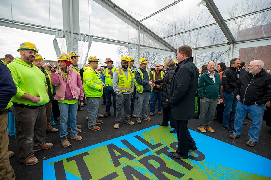 Boston Mayor Martin J. Walsh and President Drew Faust greet and thank members of the Turner Construction team.
