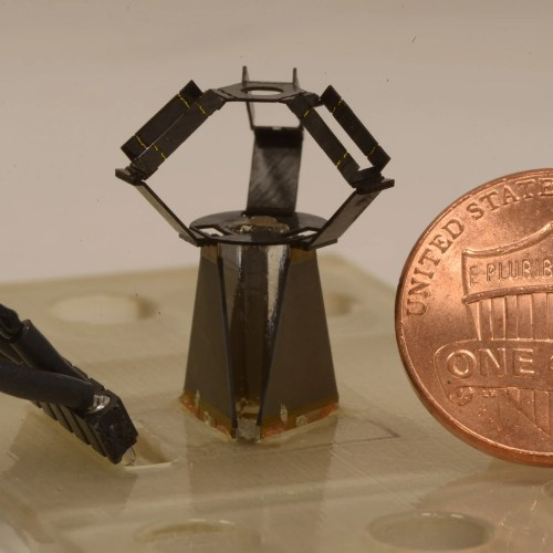 milliDelta robot next to penny