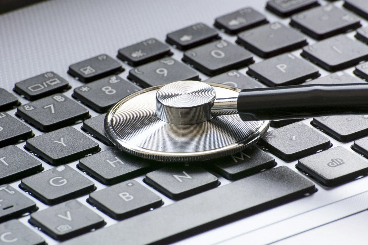 Stethoscope over a computer keyboard.
