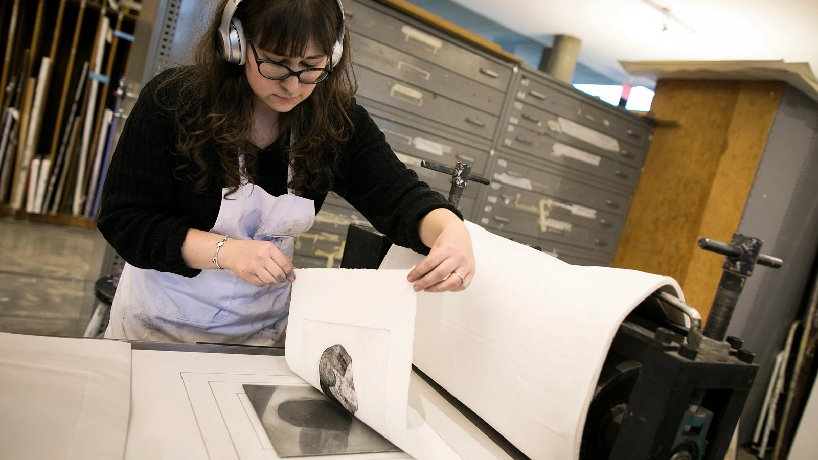 Graduate student Rachel Vogel tries her hand at printmaking.