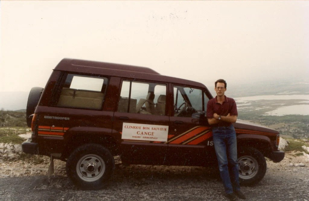 Paul Farmer in Haiti by an ambulance circa 1993.