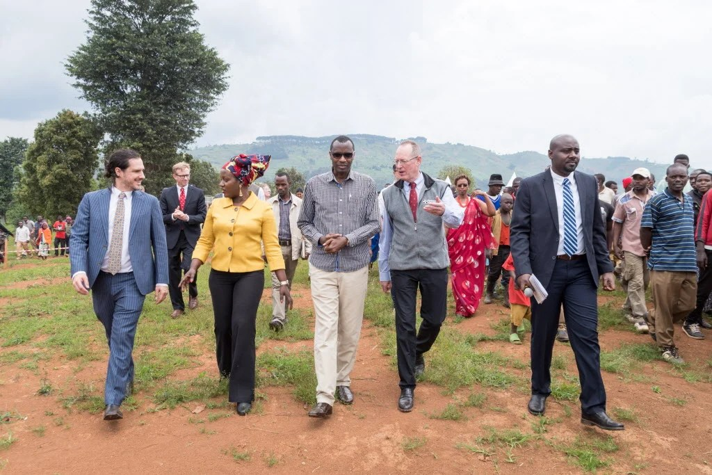 Peter Drobac, Antoinette Habinshuti, Musafiri Papias Malimba, Paul Farmer, and Emmanuel Kamanzi walk the grounds of the future University of Global Health Equity in Rwanda.