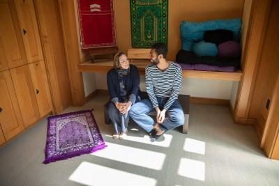 Yaseen Eldik and Sanaa Nadim pray.