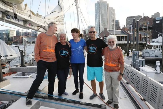 Scientists aboard the research schooner Tara; at far left is Chris Bowler and at far right is Eric Karsenti. Photo courtesy of Celine Belanger/Tara Expedition Foundation