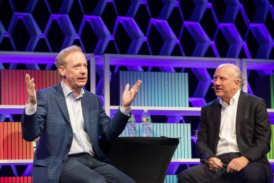 Harvard Business Review Editor-in-Chief, Adi Ignatius talks with Brad Smith (left), President and Chief Legal Officer, Microsoft
