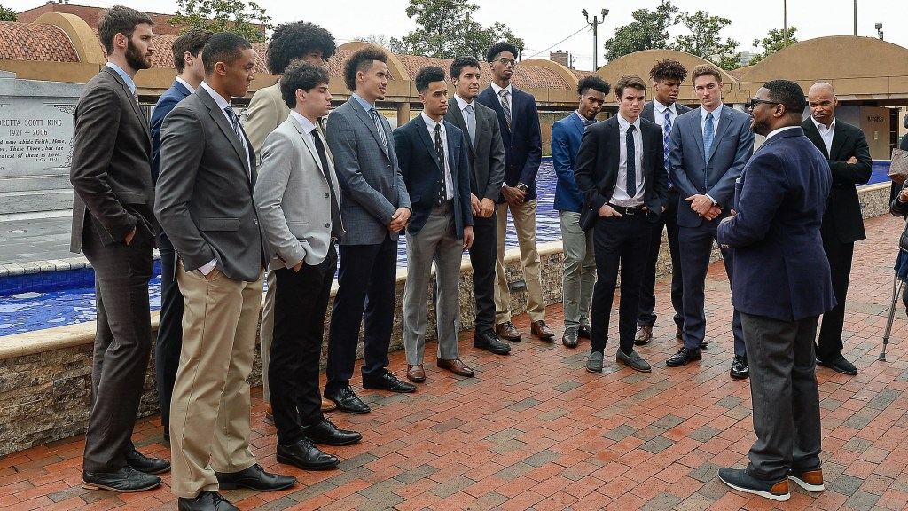 Harvard's men's basketball team visits The King Center in Atlanta.