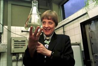 Angela Merkel holds a beaker in 1995.