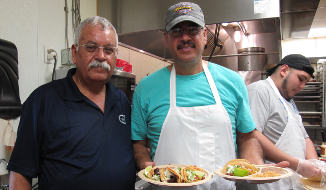Javier Arias (left) and younger brother Aurelio Arias at El Palote Panderia in Dallas. (Photo by American Heart Association News)