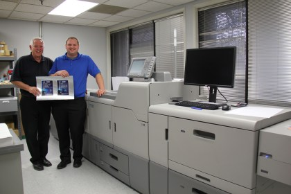Jerry and Matt Theoret next to the Heidelberg Versafire CV