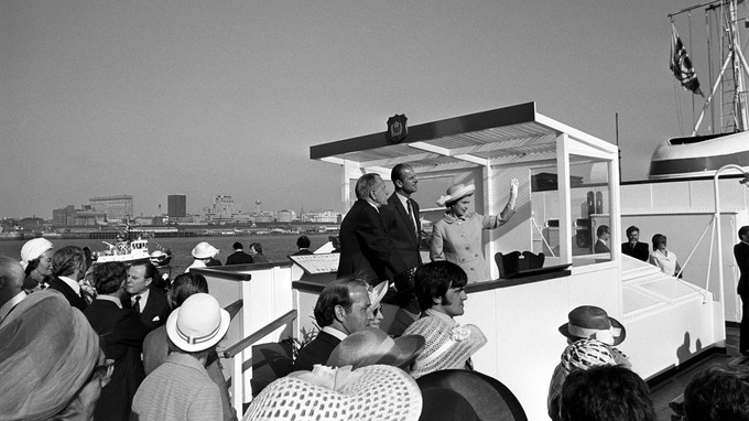 The Queen and Prince Philip aboard the Royal Iris on the Mersey in 1977.
