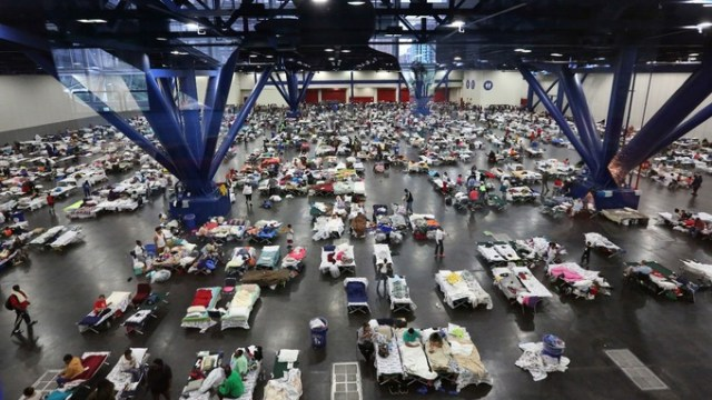 People in Houston take shelter inside a hall.