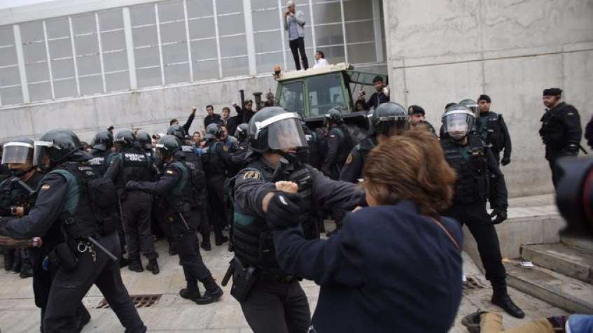 Image result for Riot police clash with voters as polls open in Catalonia's ..
