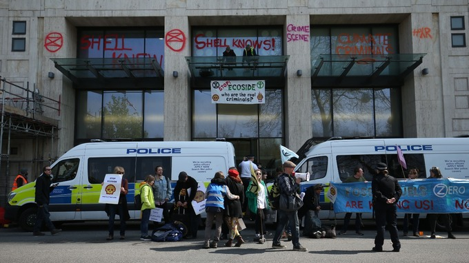 Some protesters smashed windows as they vandalised the London headquarters of oil giant Shell.