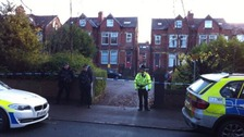 Police cordon outside property where police officer was shot