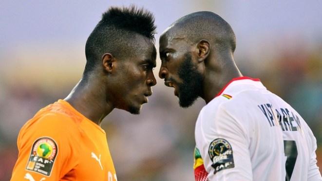 Eric Bailly of Ivory Coast (l) and Mustapha Yatabare
