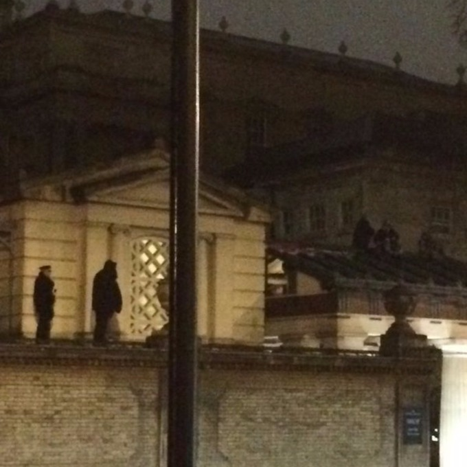 Police officers on the roof of the Queen's Gallery with the two activists