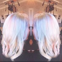 Highlights and randomly placed pastel colors give an oil slick effect to previously light brown hair.