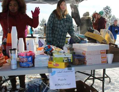 Protesters hosted a food bank drive and a school supply drive while protesting the CMAS test at Fairview High School in Boulder