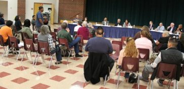 Landau testifies about his beating to the Citizens Oversight Board in 2013,