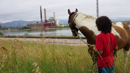 A young Lakota Rider helps prepare for the day's ride out of Boulder