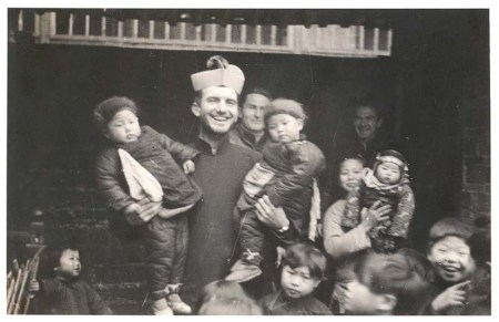 Friar Smith with orphans in China