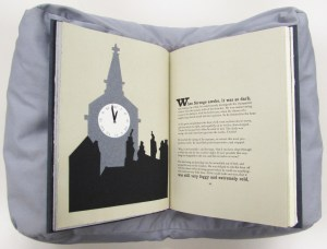 A page spread showing an image of Big Ben and text from A Christmas Carol.