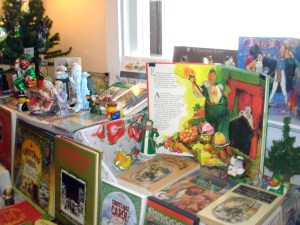 Image of a display of A Christmas Carol adaptations collected by William Shuster.