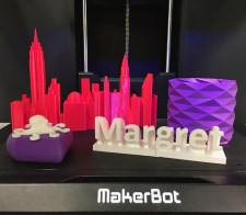 3D-printed objects like small skyscrapers, an octopus, and a person's name