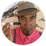 photo of cartoonist Keith Knight wearing a trilby and holding a sharpie