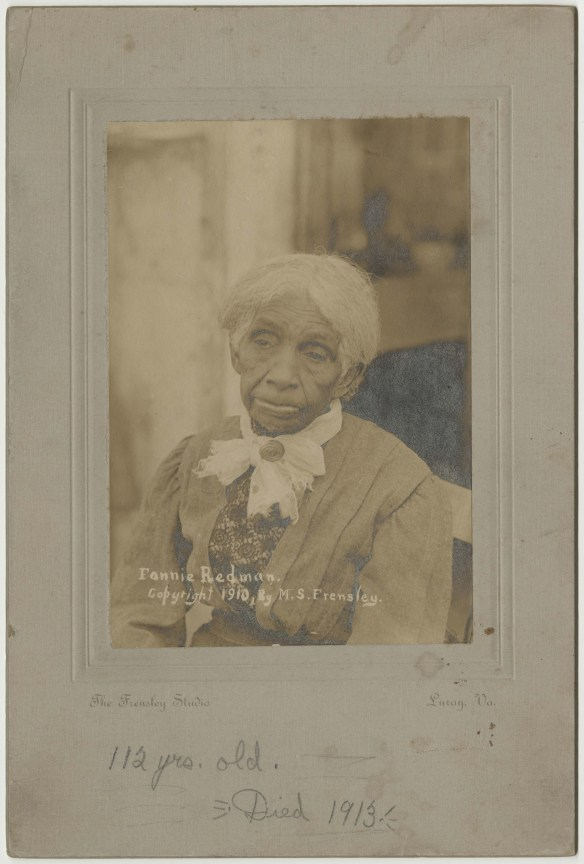 Old photo of black woman with white bow beneath her chin