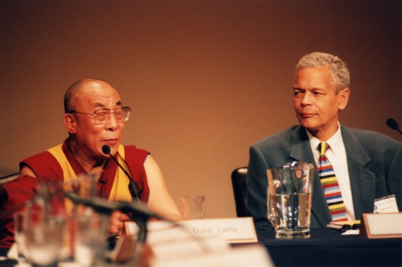 Julian Bond sits next to the Dalai Lama in a panel discussion