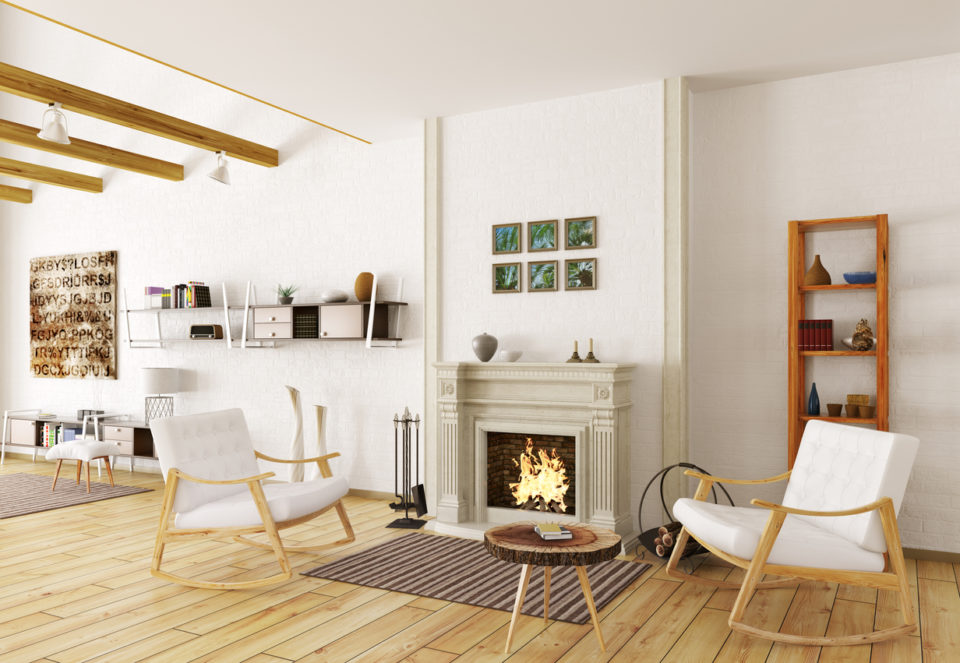 Interior of lounge room with fireplace and two armchairs.