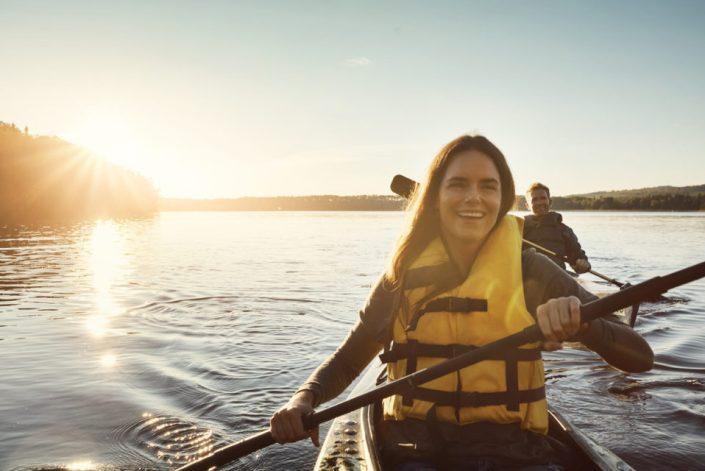 Couple kayaking on a lake outdoors