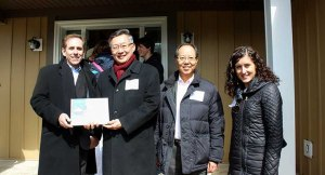 Living Group Joins Habitat for Humanity In Awarding Keys to New Home
