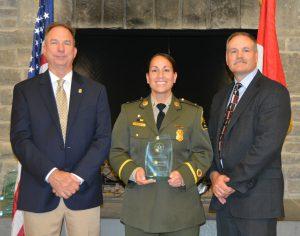 Photo of Lt. Medellin, NACLEC Pres. Eddie Henderson (left), NACLEC Executive Director Randy Stark