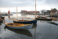 Small boats in the water at the Mid-Atlantic Small Craft Festival