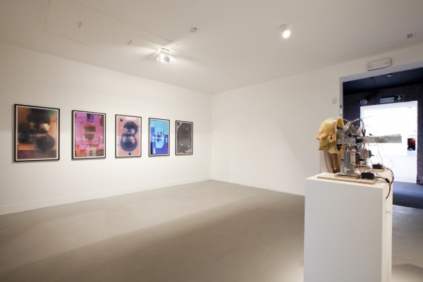 Nathaniel Mellors, installation view at ILLUMInations showing Venus of Truson (prehistoric, photogrammic originals), 2011 (left) and Hippy Dialectics, 2010 (right)