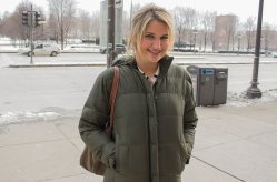 Katie McArton, Lincoln Park, walks up Michigan Avenue in an olive green puffer coat, attempting to stay warm and look professional for a morning full of job interviews. (Mallory Hughes / Medill)