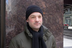 Dave Glass, Lincoln Park, opts for simplicity in a matching black beanie and knitted scarf. (Mallory Hughes / Medill)