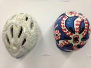 "Left: Andrew Bedno. ""Chicago Bike Map Art Helmet."" ATA bike map glue and clear coat. NFS; Right: ""Tentacled Monster Art Helmet."" Spray paint and acrylic on bike helmet. NFS (Shanley Chien/Medill)"
