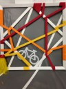 """Jane Georges. """"There is Always a Way Around It."""" Bicycle handlebar tape, bike light, streamer, found traction flooring, acrylic. $350 (Shanley Chien/Medill)"""
