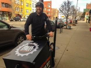 Scott Baermann sits on his cargo bike.