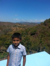 A boy from el Balsamo, stands on top of the large blue cistern that stores water for the entire village. AsoFenix and Green Empowerment have brought their projects to over 16 communities, according to Peake. (Sarah Kramer/Medill)
