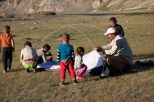 Archaeologist David Putnam sets up his tent with the help of a curious group of Kazakh children from a nearby cluster of gers. Mongolia is home to roughly 100,000 ethnic Kazakhs, making them the largest ethnic minority in the country. Aaron Putnam, David's son, led the expedition to Mongolia. (Sarah Kramer/Medill)