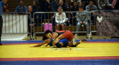 Clarissa Chun (red) competes in her first match at the Dave Schultz Memorial International wrestling tournament. (Jasmine Cannon/MEDILL)