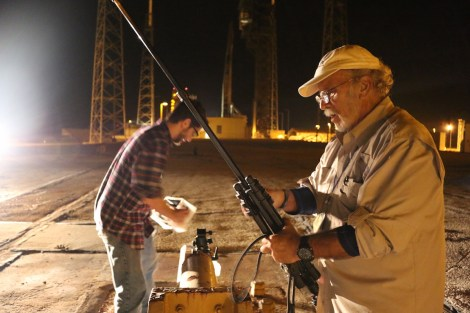 Photographer John Studwell retrieves one of his camera rigs post launch. Kelly Calagna/MEDILL