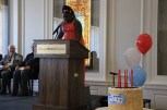 """Jayla Johnson, the winner of the Friends of DuSable Essay Competition, read her essay at the ceremony. """"People can't solve problems by shooting each other and innocent people,"""" she wrote. """"Mr. DuSable would want children to be safe and grow up to be good citizens."""" (Wenjing Yang/MEDILL)"""