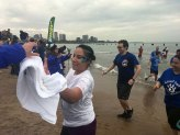 Plungers are handed towels after they exit the water. (Katie Watkins/MEDILL)